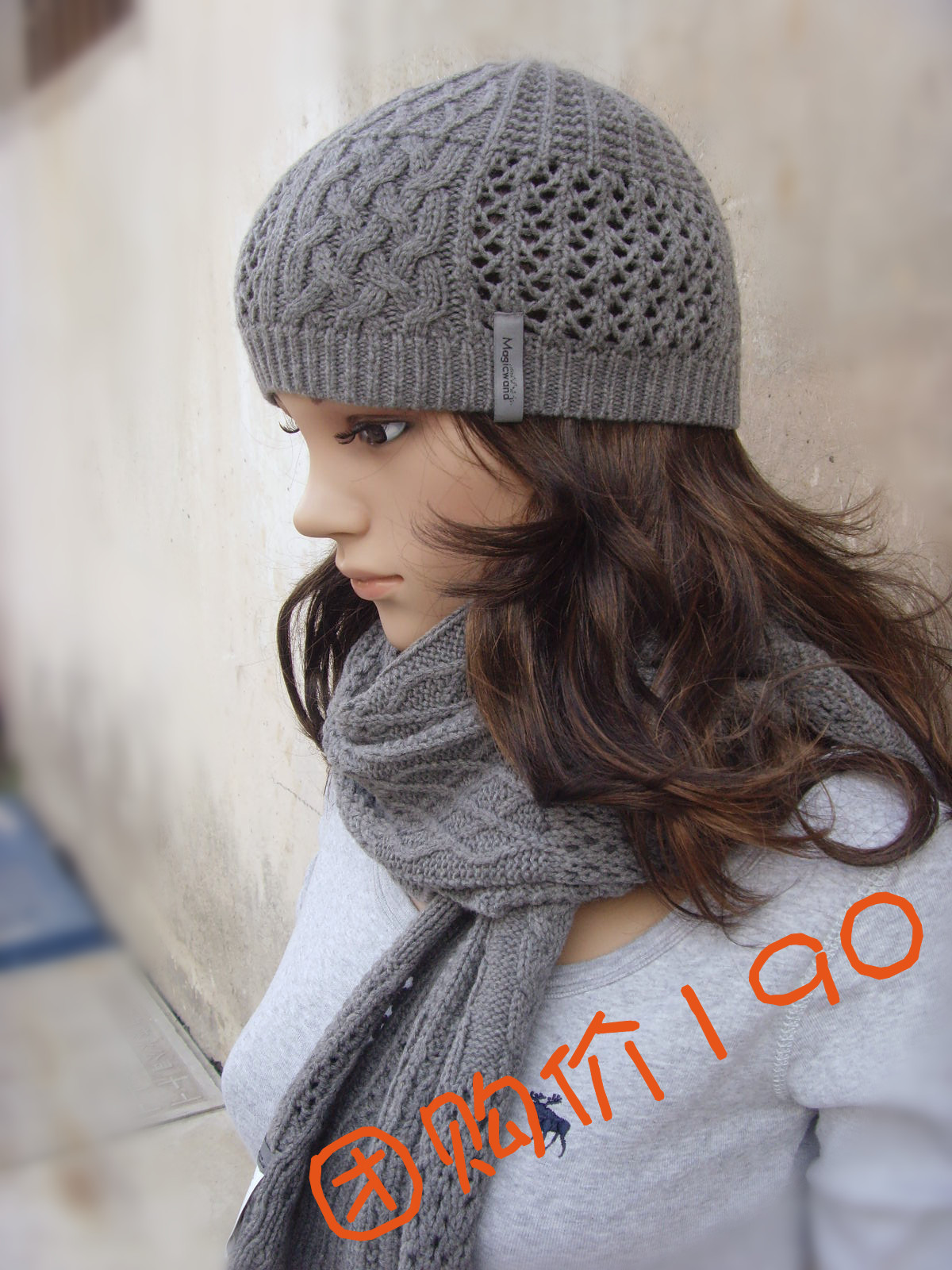 Three pieces of woolen scarf gloves and hats for men and women