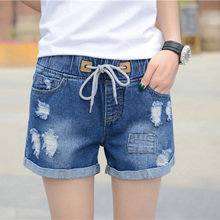 In the summer of 2017 fat MM denim shorts female loose baggy pants elastic waist slim tassel Shorts Size tide