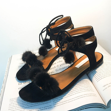 In the spring of 2017 Korean lace toe hollow fashion shoes with a hair ball hair flat sandals shoes