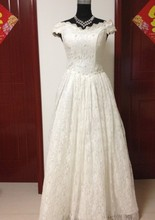 A swing thin Beaded Lace Wedding Dresses seven sleeves are sleeved shoulder a big bow