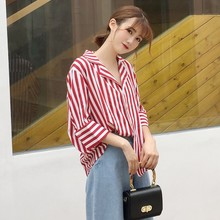 The new female Korean chic loose thin single row multi button seven button Cuff Gold striped shirt blouse
