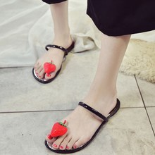 The new mixed fruit sandals sleek hi flat casual beach transparent jelly shoes pinch female students.