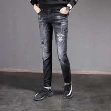 Europe embroidery ripped jeans slim black Korean youth male feet thick section jeans in autumn and winter