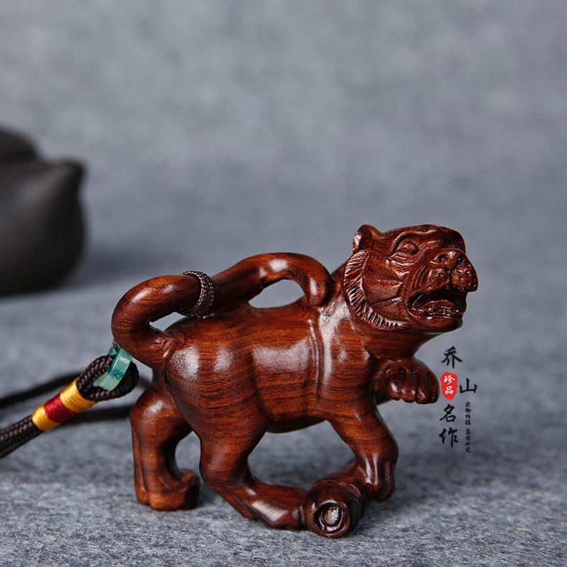 Huanghua Limu handles the twelve zodiac tigers and animals to play against evil red wood carving small pendants for parcel postage