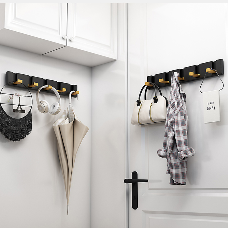 Clothes hook a row of doors behind the hanger hanger hook wall hanging wall long strip hanger invisible hook hole-free