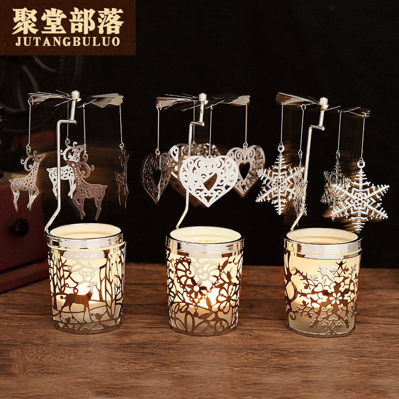 The Holiday is decorated with European-style automatic rotating candlestick wind-car cup candles and creative gifts from male and female friends