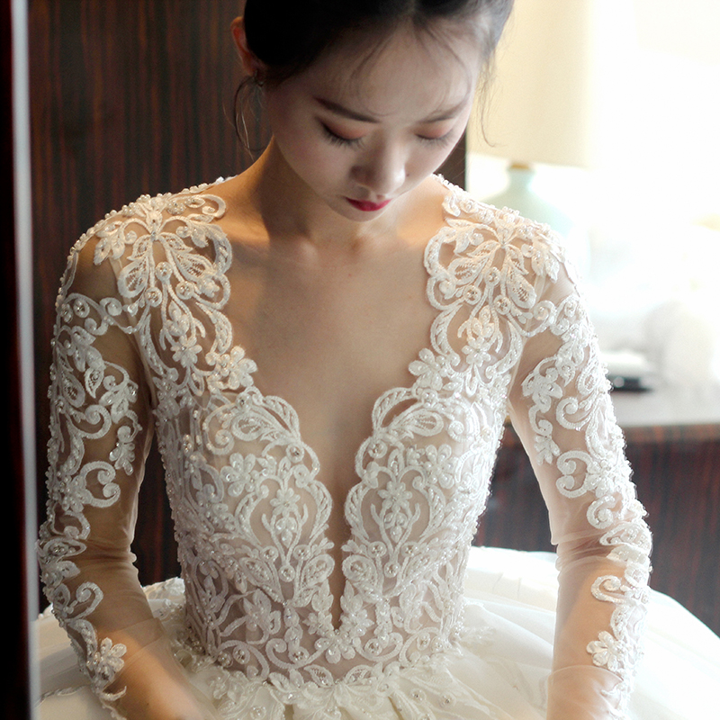 Main wedding dress 2020 new bride super fairy dream forest series one word shoulder show thin long sleeve drag tail spring simple wedding dress
