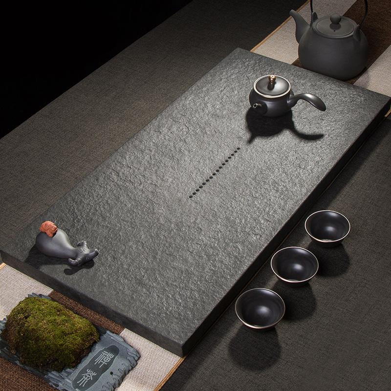 The whole natural wujin stone tea plate home simple Chinese large medium-size primary stone tea plate black gold stone office tea sea