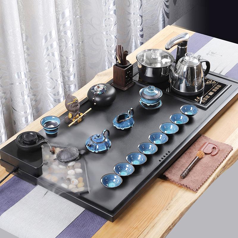 The whole set of Wujin stone tea set family kung fu tea plate living room simple purple sand atomized flowing tea table fully automatic