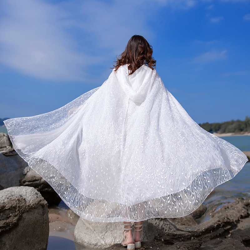 The new fairy white shawl cape hooded holiday sunscreen loose lace long cardigan embroidered with a daughter-in-law
