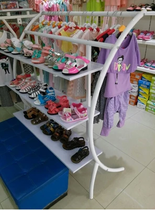 High-end clothing shelves semicircle clothing display rack floor shoe cabinet in the island cabinet Mother Baby Child clothing store shelves