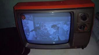 19 04] Old-fashioned 12-inch black-and-white TV, classic