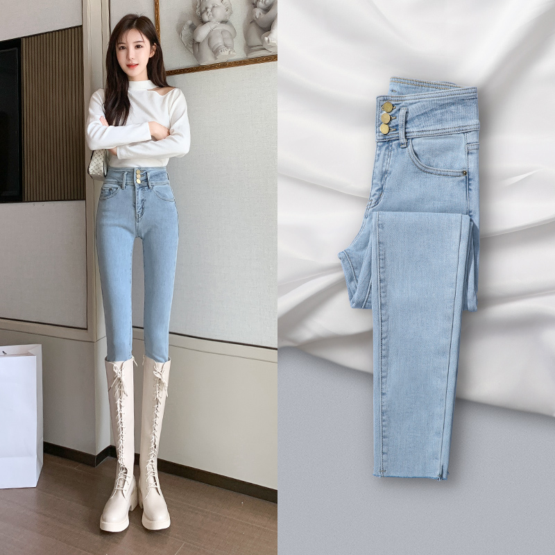 High-waisted light-colored jeans womens 2020 new autumn winter show thin tight plus velvet light blue small feet womens pants wear outside