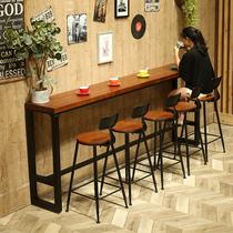 Fer à repasser en bois de pied contre la paroi de la table de bar café domestique de thé au lait de gestion de la table de bar américain de combinaison de tables et de chaises