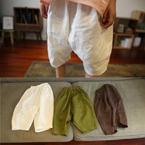Original new summer childrens clothing Boys and girls cotton and linen solid color large PP three-point pants Childrens linen loose radish shorts