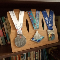 China frame medal collection shows horse race results medal hanging Larsson cross-country running award display table.