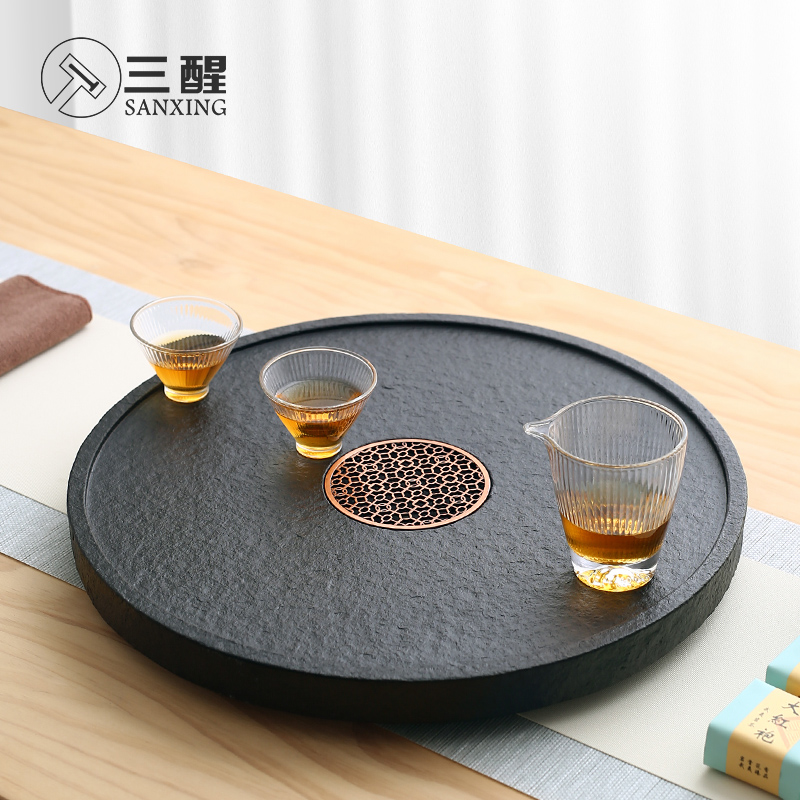 Simple stone small tea table whole piece of wujin stone tea plate round home tea sea Japanese kung fu tea tray