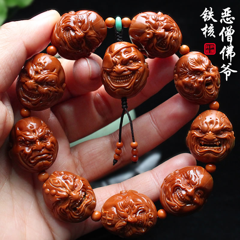 Zhoushan Su Gong olive core carving Handmade carving iron core seed Evil monk Buddha olive Hu Wen play hand string men