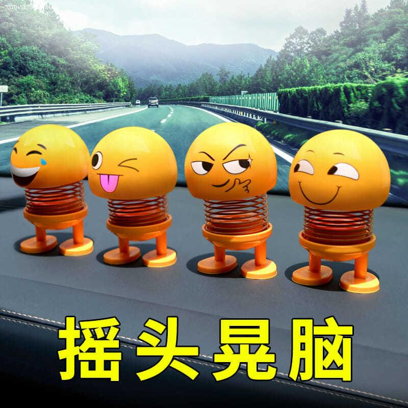 Inside the car shake the head doll car put on a little yellow man funny spring expression bag toy shake sound the same doll