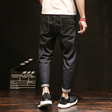 Black jeans male loose Japanese casual stretch trend of large size harem pants nine pants men's feet pants