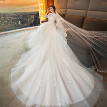 Wedding gown with white lace and trailer