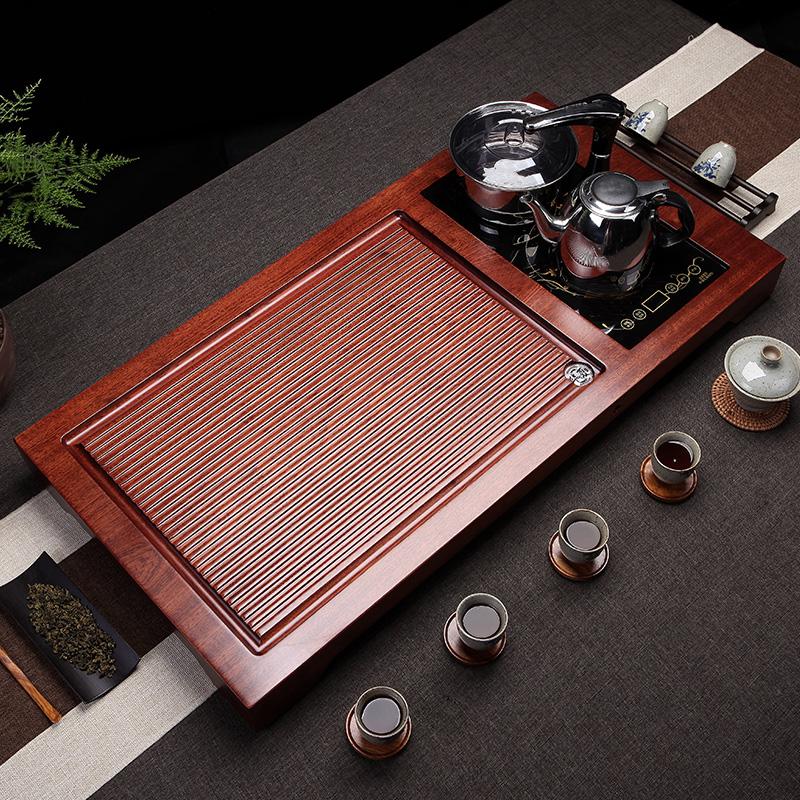 The whole pear wood tea plate purple sand kung fu tea set home solid wood four-in-one tea table tea sea induction cooker