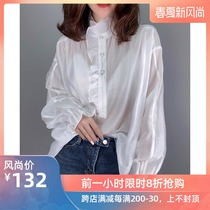 White new blouse with loose flounce sleeves