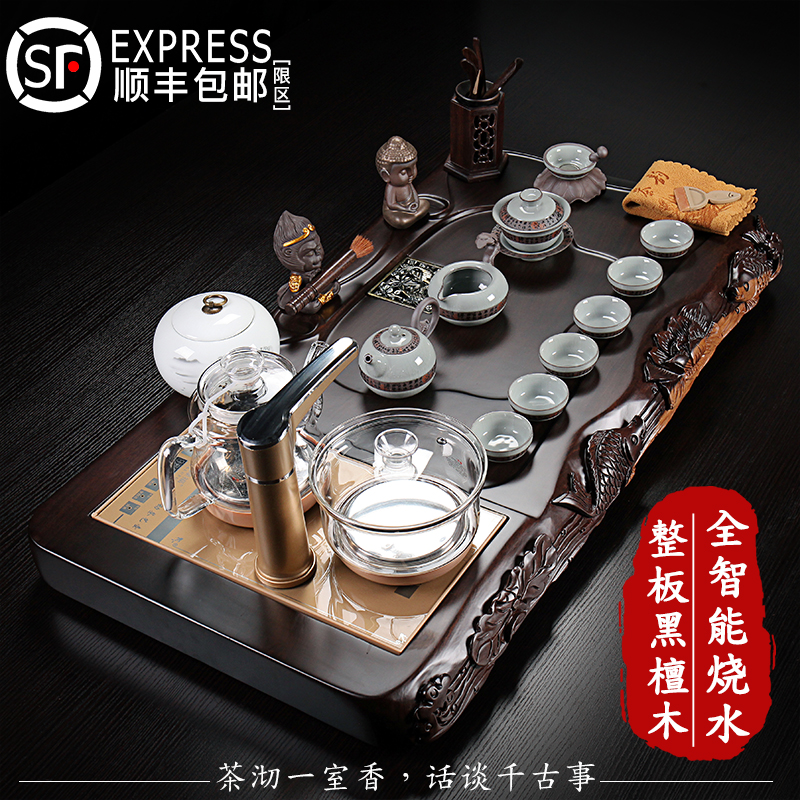 The whole board of black sandalwood tea plate ceramic purple sand kung fu tea set Chinese lotus fish carving automatic electrical household