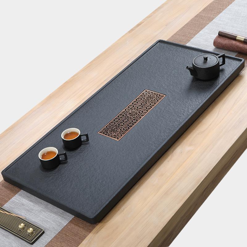 Natural wujin stone tea plate whole piece of household modern simple stone tea table size stone tea sea tea set