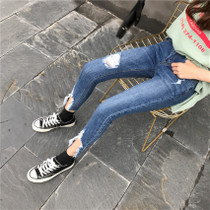 Korean hole raw edge jeans girl Korean version of slim feet pencil trousers worn a nine-point stretch pants spring
