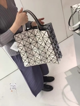 Xu a letter Japanese purchase Miyake Issey MIYAKE six lattice 34cm pure color hand bag