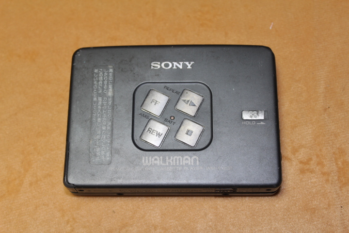 2-Handed Sony EX633 Tape Walkman is in good condition